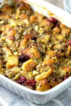 Thanksgiving Sausage, Cranberry & Apple Stuffing - Happily Unprocessed - - Our familys tried & true stuffing recipe 15 yrs + now with sausage, small bits of apples and dried cranberries, sage, rosemary and thyme. It's perfect! Stuffing Recipes For Thanksgiving, Thanksgiving Sides, Christmas Recipes, Thanksgiving Desserts, Christmas Desserts, Holiday Recipes, Sage Sausage, Ground Sausage, Apple Stuffing