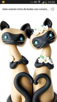 picture of two polymer clay cats.  They remind me of the ones from Lady and the Tramp