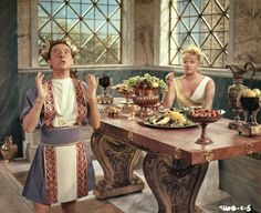 Julius Caesar (Kenneth Williams) is not best impressed with the welcome home he receives from his wife Calpurnia (Joan Sims) in Carry On Cleo.