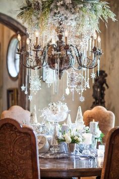 Elegant Christmas Table with Snowflakes Hanging from the Chandelier
