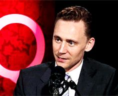 Tom Hiddleston slow smile (gif).  OH...MY....HIDDLES....