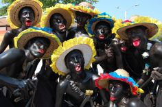 Columbia -- During Carnaval de Barranquilla men paint themselves in blackface and make twitching faces that are supposed to resemble what black people look like. Cali, Chase Online, Costume, Black People, Fascinator, Carnival, Around The Worlds, History, Country