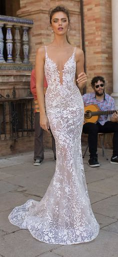 Sexy lace wedding dress with plunge neckline by Berta Bridal.