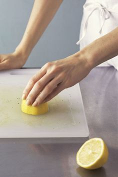 Run the cut side of a lemon over the board to remove food stains and smells. For extra cleaning power, sprinkle it with salt or baking soda first.