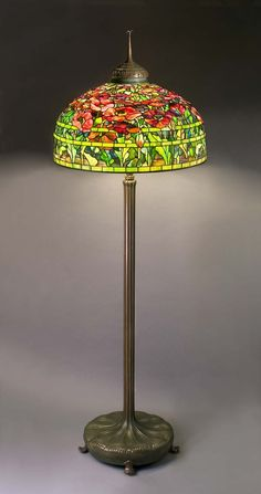 TIFFANY STUDIOS (1902-1938), Banded Poppy Floor Lamp, after 1906, leaded glass and bronze, shade: 26 inches diameter, base: 69 ½ inches high. From the exhibition Tiffany Studios: The Holtzman Collection