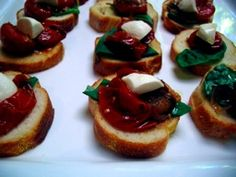 Crostinis With Olive Oil And Balsamic Roasted Cherry Tomatoes, Basil And Bocconcini
