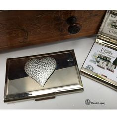 "Our heart silver business card holder is embellished with the hammered heart . It is 3 1/2"" x 2 1/2"" and holds standard-sized business cards and credit cards. Jewelry Dish, Shell Jewelry, Gifts For Wine Lovers, Wine Gifts, Business Card Holders, Business Cards, Great Wedding Gifts, Wine Bottle Stoppers, Bridesmaid Gifts"