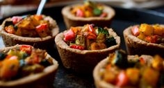 Use a mini-muffin tray to form the shells for these crowd-pleasing butternut squash and zucchini tarts. The vegetable filling is made quick and easy by using a wok to cook the vegetables. (Photo: Andrew Scrivani for The New York Times)