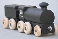 "Black toy wooden locomotive, named ""Old Pete"""