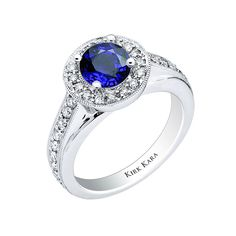 18k white gold and diamond ring with round sapphire