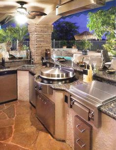 Circular Cooktop in Outdoor Kitchen #Appliances #Backyard #Kitchen  View luxury real estate listings at www.seattleluxurylifestyle.com                                                                                                                                                                                 More