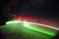 Many auroras appear green, but sometimes other colors such as red show up—as in this picture taken from the International Space Station on September 26.    An aurora's colors depend on which types of atoms cause the splash of light. In most cases, auroral lights appear when charged particles from the solar wind collide with oxygen atoms in Earth's atmosphere, according to a NASA statement.