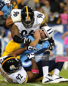 Defensive end Ziggy Hood #96 and linebacker James Harrison #92 of the Pittsburgh Steelers sack quarterback Matt Hasselbeck #8 of the Tennessee Titans in a Thursday Night Football game October 11, 2012 at LP Field in Nashville, Tennessee.