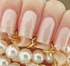 Gold glitter on nude nails