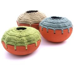 podkins:  How amazing are these clay-and-yarn pots from artists Natalia Ortega Gamez, an artist in the Dominican Republic? (Click here to check out her site.) Featured on Crochet Today.