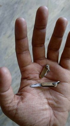 1 Miniature Mini Folding Knife, via Etsy.