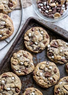 Skip the campfire and whip up a batch of S'mores Cookies! Made with graham cracker cookie dough, chocolate chips & marshmallow bits, these s'mores cookies taste just like your favorite summer treat so you can have s'mores year round. Smores Cookies, Cookie Desserts, Yummy Cookies, Just Desserts, Yummy Treats, Cookie Recipes, Delicious Desserts, Sweet Treats, Dessert Recipes