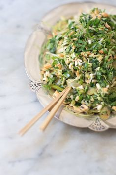A Good Shredded Salad - inspired by the much-loved, shredded cabbage composition found on a good number of menus near our studio in San Francisco's Chinatown - green layered on green layered on green. It is all about the play between shredded ingredients like cabbage and scallions, and crunch from ingredients like cabbage, and peanuts, and celery.