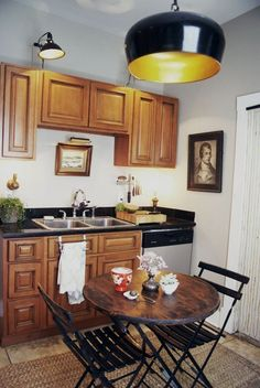 Smart Solutions for Small Cool Kitchens - brown cabinets and double sink