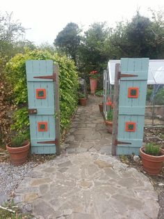 Beautiful doors as an entry way in to a section of the herb garden in Burren perfumery and floral centre