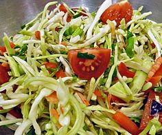 Asain Broccoli Slaw, a bowl of crisp sunshine in winter. Not enough flavour, more sesame oil less other oil would be better. And make sure it is a good quality strong flavoured sesame oil.