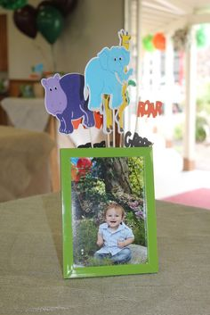cute idea for centerpiece-pics with little animals around