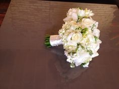 A beautiful all white bouquet designed by Eastern Floral.  Flowers include Hydrangea, freesia, lisianthus, roses, stock and spray roses.