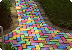 Different colour slabs or bricks make a fun path to the kids play area. Lovely splash of colour to garden in winter as well.