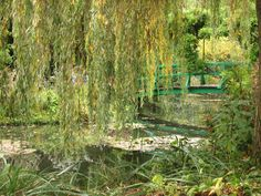 Claude Monet's garden of waterlilies and the iconic Japanese bridge in Giverny, France.