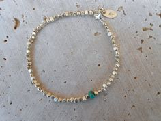 Bracelet, 2mm Thai silver smooth rough-cut beads with turquoise rondelle. 7 inches; can extend to 7.5 inches. All other findings are sterling