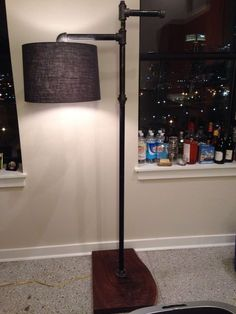 Black gas pipe floor lamp with ancient walnut base. Crafted by a talented friend. Had to share.