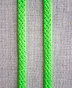 Neon Lacing from Purl Soho: Punch up your projects with our groovy Neon Lacing! We love it for drawstring closures: pants, skirts, bags and hoodies. It's also great for arts and crafts projects, Halloween costumes, and just about anywhere you want to tie it up with a burst of color! This 100% polyester lacing measures 1/4-inch wide and is sold by the yard. $3.60