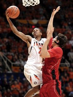 Illinois guard Joseph Bertrand, left, is fouled by Nebraska center Jorge Brian Diaz as he drives to the basket in the second half of an NCAA college basketball game in Champaign, Ill. Jan. 7, 2012. Illinois beat Nebraska 59-54. (AP Photo/John Dixon)    I still ask: why are you wearing a face mask??