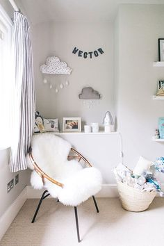 A modern stylish unisex baby nursery with a neutral grey colour scheme with blue and green accents and a grey cot from Marks and Spencer and grey striped curtains from John Lewis and Ribba shelves from Ikea. Ikea Baby Nursery, Cloud Nursery Decor, Clouds Nursery, Nursery Chairs, Nursery Ideas, Girl Nursery, Bedroom Ideas, Grey White Nursery, Grey Cot
