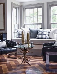 Have I ever mentioned how in love I am with the color gray? I love the pillows on the couch and the trim around the windows; it softens the look of the windows without distracting from the view.