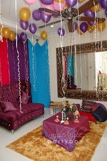 Aladdin party. Love the purple & gold balloons!
