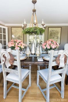 Silver and gold Christmas trees along with a pair of poinsettias used to decorate this dining table for Christmas!