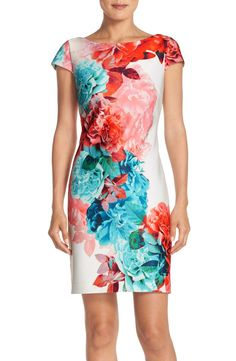 Lush, vibrant flowers bloom wildly across this figure-flattering dress that is perfect for spring.