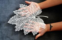 Paper cut leaf (maud white?), just takes a day or two of quiet time, added with a ton of love, and three tons talent and skills.
