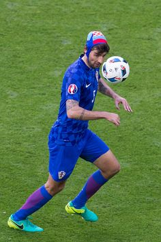 Croatia's Vedran Corluka wearing protective headgear from an earlier injury during the UEFA Euro 2016 Group D match between Czech Republic and...