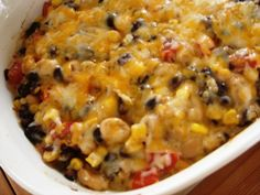 Black and White Bean Dip  Ingredients:  1 can black beans  1 can white beans  1 can of corn  7 oz. salsa verde  2 cups shredded co-jack cheese  4-6 chopped roma tomatoes  garlic salt to taste  avocado – optional