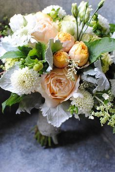Bridal bouquet of caramel antik garden roses, white dahlias, white lisianthus, dusty miller, and Angel's blush hydrangea.