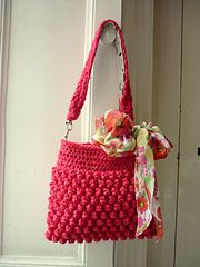 A Raspberry Bag, using bobble stitches.  Pattern link available.