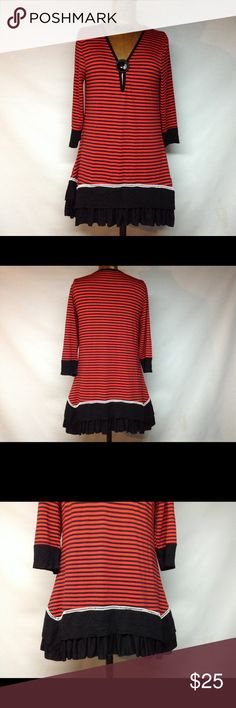 Red and black strip tunic Red and black strip with front button for show. With v neck style .Bottom is wavy with high low feature - arm slightly coming away - the top was never worn - armpit to arm pit 17 inches . Laid flat back measures top to bottom 31 inches. 65% polyester 35% rayon. -Aster brand Tops Tunics