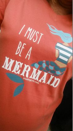 I must be a mermaid t-shirt: https://www.etsy.com/listing/241376639/i-must-be-a-mermaid-ladies-v-neck-tshirt