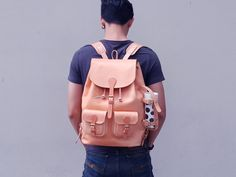 """SCOUTIII"" Mens Geuine Leather Backpack with water bottle holder Clean & Classic Design for Everyday Usage. The more you use, the more you get the beauty on it.  Handmade in Thailand  Exterior : -Made of high quality genuine 1.8 MM and 4 MM Veg Tan Leather. -Top closure with leather drawstring and belt. -2 pockets on bags front ( 4.5 Width x 5 Height x 1 Depth ), with belt closure. -With special design for holding water bottle on its side. -Hand sewn with nylon tread.   Interior: -No line..."
