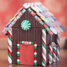 This sweet display is easy to make -- each house is built with candy bars, using melted chocolate to hold it together. Add other edible embellishments before arranging houses in a tiny village. Holiday Candy, Christmas Candy, Christmas Cookies, Christmas Time, Christmas Crafts, Christmas Decorations, Holiday Desserts, Holiday Decor, Cool Gingerbread Houses