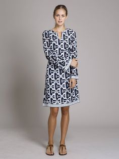 Kaftan with trim to the knee.Show some leg. Long sleeves with cotton lining. Trim at the neck, the cuff and the hem. Classy and yet shows your figure. V Neck. Looks great with the Harbour Island pants in matching print.