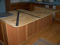 Steel bars routed into plywood to support overhang of island countertop Concrete Kitchen, Granite Kitchen, Kitchen Countertops, Kitchen Island, Wooden Corbels, Wood Brackets, Home Remodeling, Home Kitchens, Kitchen Remodel