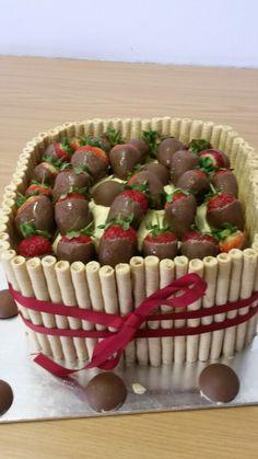 Chocolate birthday cake with choc dipped strawberries